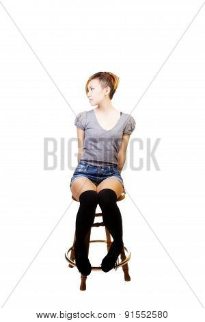 Attractive Asian American Woman Sitting On Stool