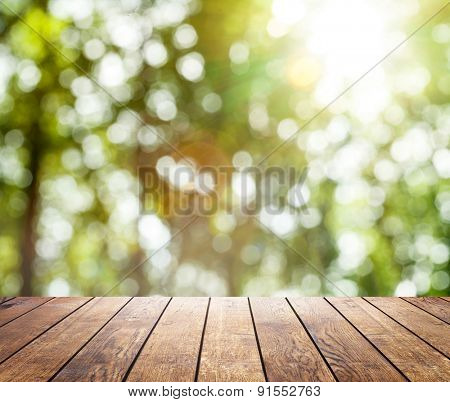 Beautiful sunlight in the spring forest with wood planks floor interior background