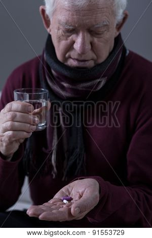 Elderly Man Taking Medicine