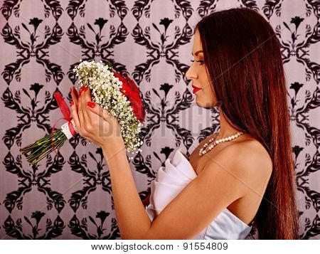 Happy  bride in wedding dress on wallpapers bachground.