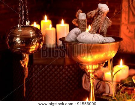 Luxury ayurvedic spa massage still life with burning candles.