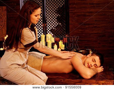Young handsome man having oil Ayurveda spa treatment.