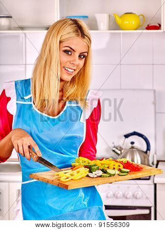 Happy woman cooking on wooden board breakfast at kitchen.