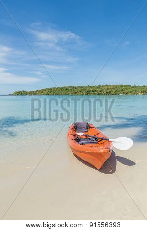 Summer, Travel, Vacation And Holiday Concept - Orange Kayaks On The Tropical Beach, Thailand