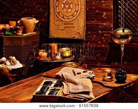 Luxury ayurvedic spa massage interior with stones.