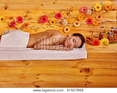 Young woman waiting for a massage therapist in Spa.