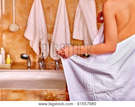 Woman relaxing at water in bubble bath.  In frame of visible part female