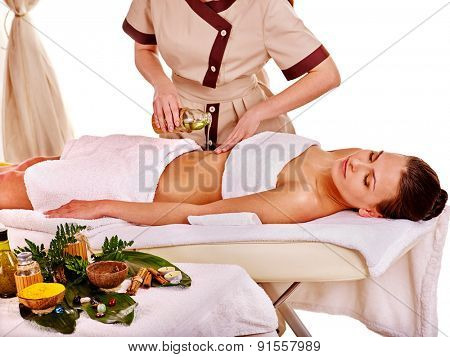 Young woman getting spa pouring oil therapy . Isolated.
