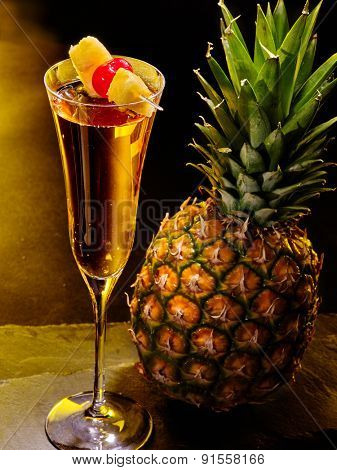 Champagne  cocktail with cherry and whole pineapple with leaves . Cocktail card 59.