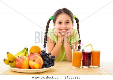Happy girl with fruits and juice