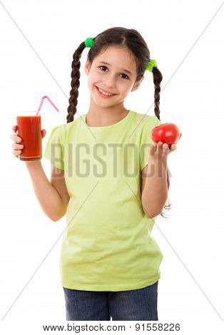 Smiling girl with tomato and glass of juice