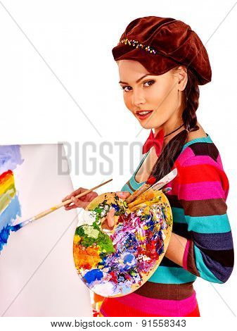 Artist woman holding palette at work. Isolated.