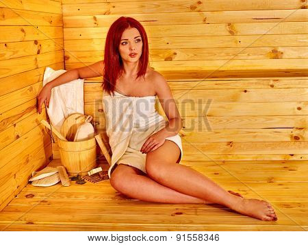 Young slim woman in sauna.