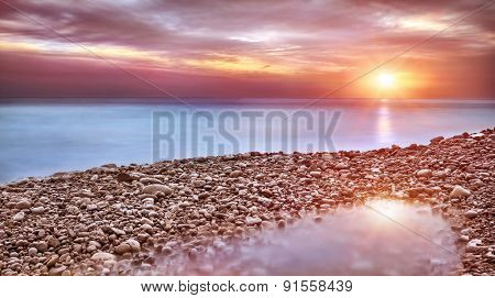 Beautiful beach landscape, amazing view on pebble coast in mild sunset light, wonderful place for romantic holidays, beauty of nature