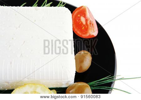 image of feta cube on black plate