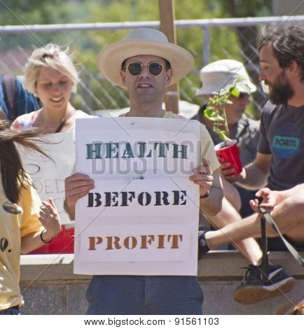 Health Before Profit Sign At A Gmo Protest Rally