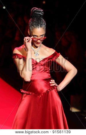 NEW YORK-FEB 12: Chef Carla Hall wears Evgenia at Go Red for Women-The Heart Truth Red Dress Collection at Mercedes-Benz Fashion Week at Lincoln Center on February 12, 2014 in New York City.