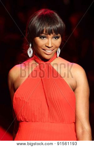 NEW YORK-FEB 12: TV personality Cynthia Bailey wears Jovan O'Connor at Go Red for Women-The Heart Truth Red Dress Collection at Mercedes-Benz Fashion Week on February 12, 2014 in New York City.