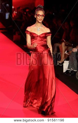 NEW YORK-FEB 12: Chef Carla Hall wears Evgenia at Go Red for Women-The Heart Truth Red Dress Collection at Mercedes-Benz Fashion Week at Lincoln Center on February 12, 2015 in New York City.