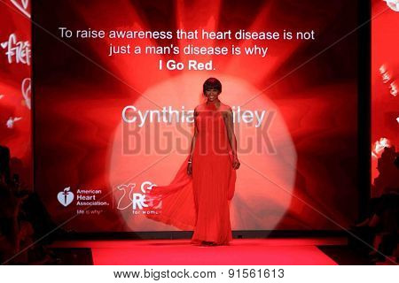 NEW YORK-FEB 12: Cynthia Bailey wears Jovan O'Connor at Go Red for Women-The Heart Truth Red Dress Collection at Mercedes-Benz Fashion Week at Lincoln Center on February 12, 2015 in New York City.