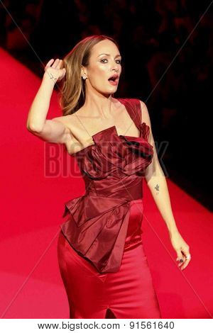 NEW YORK-FEB 12: TV personality Cat Sadler wears Oscar de la Renta at Go Red for Women-The Heart Truth Red Dress Collection at Mercedes-Benz Fashion Week on February 12, 2015 in New York City.