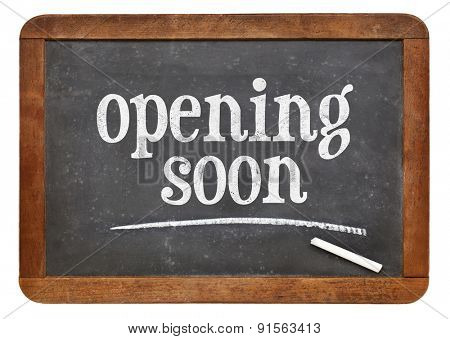 opening soon sign - text on a vintage slate blackboard