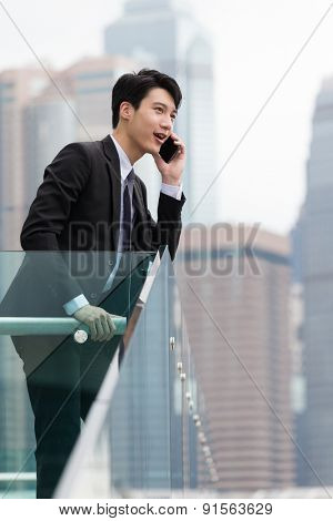 Businessman talk to cellphone in Hong Kong