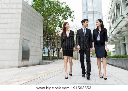 Business team mate walking on the street