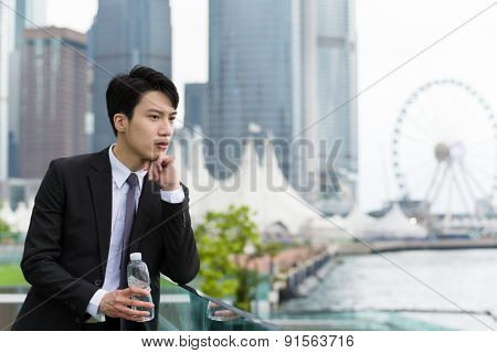 Businessman think of idea and hand holding the water bottle