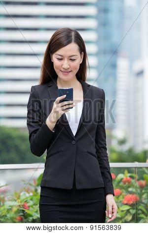 Businesswoman read on cellphone