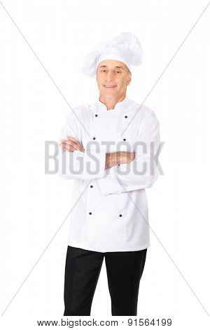 Professional experienced chef in white uniform and hat.