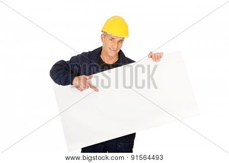 Happy worker presenting empty banner.