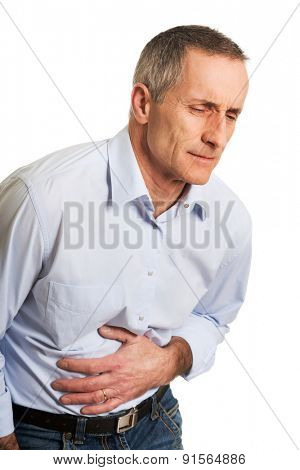 Portrait of mature man suffering from stomachache.