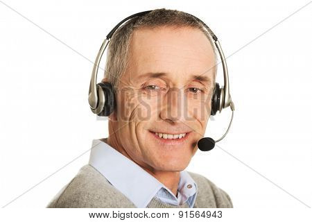 Portrait of call center man wearing a headset.