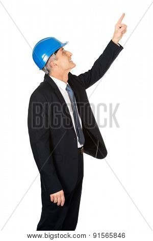 Side view of businessman engineer pointing up.
