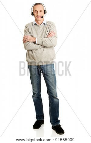Full length of call center man with folded arms.
