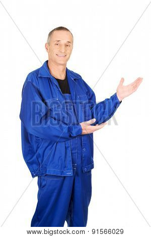 Smiling repairman showing copy space.