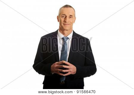 Portrait of businessman with clenched hands.