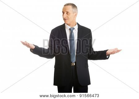 Smiling businessman holding copyspace in both hands.