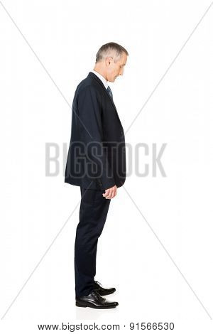 Full length side view businessman standing.