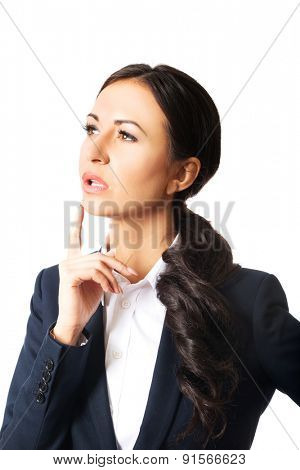 Portrait of thoughtful businesswoman with a finger under chin.