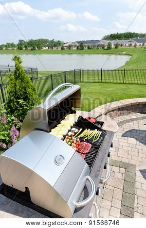 Food Arranged On An Outdoor Barbecue