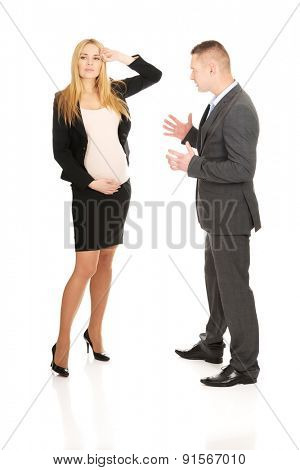 Businessman arguing with his pregnant business partner