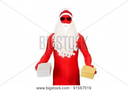 Santa in latex clothing holding gifts.
