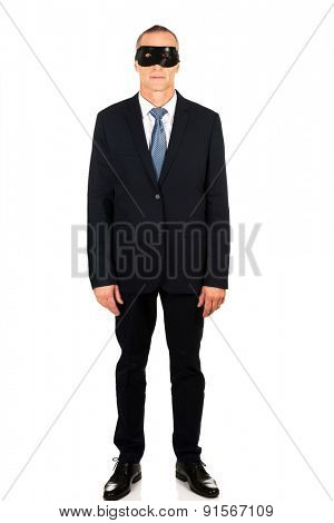 Smiling mature businessman wearing eye mask
