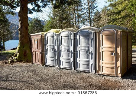 Portapotty In A Park Yard For Public Convenience