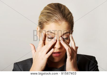 Young beautiful woman with eyes pain