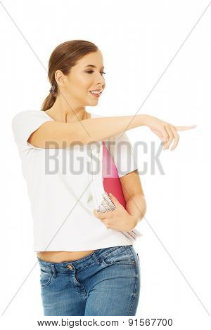 Young beautiful woman holding notebooks