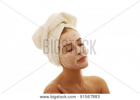 Portrait of relaxing woman cream lotion on face