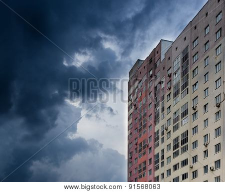 Modern High-rise Apartment And Cloudy Dark Sky